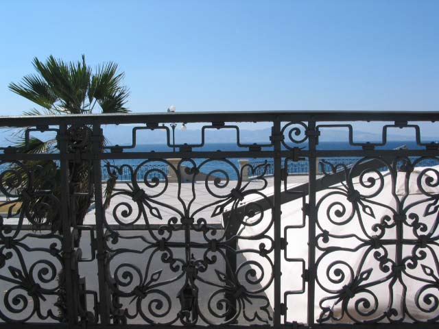 Reggio Calabria wrought iron gate Sicily in the distant