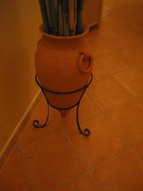 wrought iron base for terra cotta urn